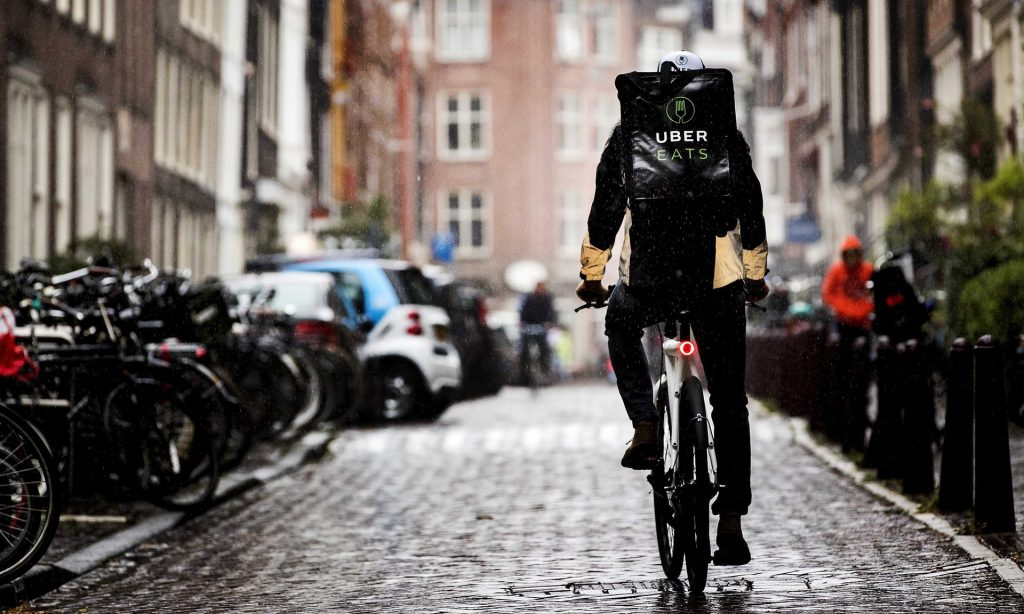 Food delivery apps like Uber Eats and Deliveroo might reduce passing trade for restaurants – but many businesses claim the services help them survive. Photograph: Koen van Weel/EPA